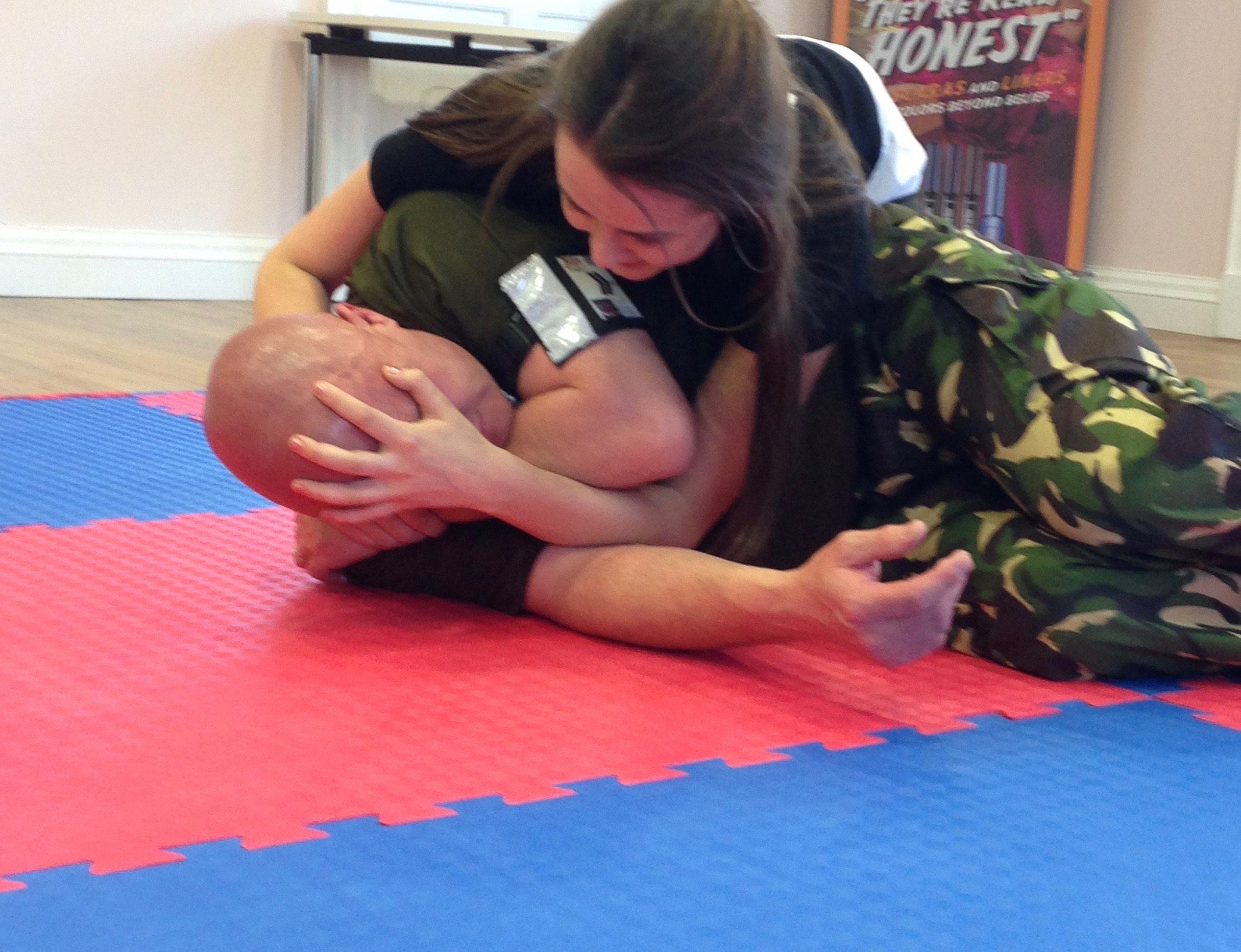 Girl practicing incapacitation technique with instructor